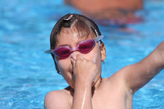 Child learning to swim, swimming lesson Stock Images