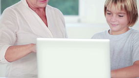 Child learning to use laptop stock footage