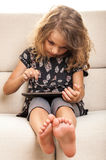 Child learning using digital tablet Stock Photos