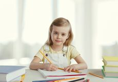 Child learns. Attractive back background beautiful book caucasian stock photos