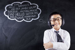 Child learns multilingual with headphones Royalty Free Stock Photos