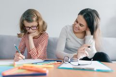 Child learns with a teacher, private individual lessons.  royalty free stock photo