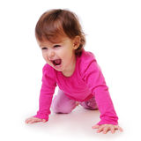 Child learns to crawl stock image