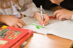 The child learns to draw. Royalty Free Stock Photography