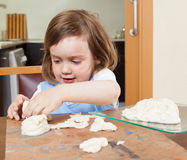 A child learns to make dough figurines Royalty Free Stock Photos
