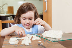 The child learns to mold dough figurines Stock Photography