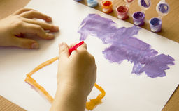 The child learns to paint Stock Image