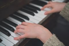 Child learns the piano. Child learns to play the piano at school royalty free stock photography