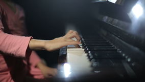 The child learns to play the piano. stock footage