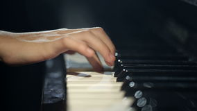 The child learns to play the piano. stock video footage
