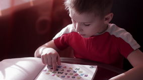 A child learns to read in home stock footage