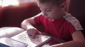 A child learns to read in home stock video footage