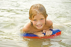 Child learns to swim Royalty Free Stock Photos