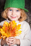 Child with leaves Royalty Free Stock Images