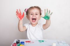 The child leaves her handprints on paper. royalty free stock images