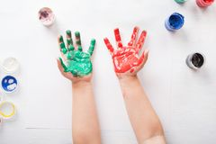 The child leaves his handprints on paper. Top view stock photo