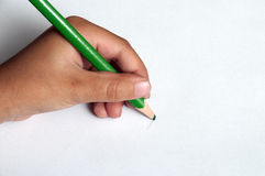 Child left-handed writing Stock Photography