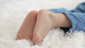 Child legs close-up stock footage