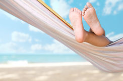 Child legs on hammock. At sea beach royalty free stock photos