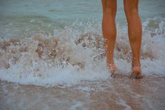 Child legs playing at the beach Stock Photography