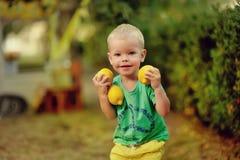 Child with lemons stock photos