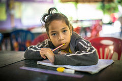 Child in lesson at school by project Cambodian Kids Care Stock Image