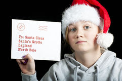 Child with a letter for santa Royalty Free Stock Images