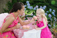 Child Licking Pink Cupcake Royalty Free Stock Photography