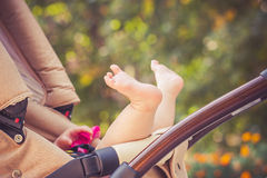 Child is lie in a carriage. Stock Photography