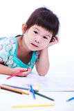 Child lie on the floor and drawing on paper.  On white Royalty Free Stock Photos