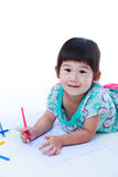 Child lie on the floor and drawing on paper.  On white Stock Photos