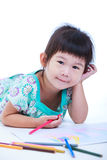 Child lie on the floor and drawing on paper.  On white Stock Photo