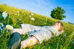 Child lies on the grass Stock Image