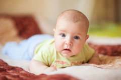 The child lies on his stomach Royalty Free Stock Photography