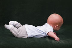 The child lies on a stomach Royalty Free Stock Photography