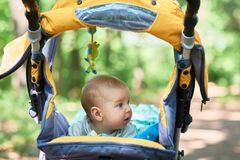 The child lies in a stroller on his stomach Royalty Free Stock Photography