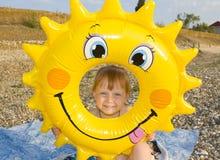 Child with life buoy. Happy child with life buoy at coast Royalty Free Stock Photography