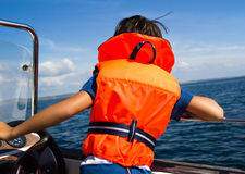 Child with life vest. Photograph of a young boy with a life vest, child safety concept Stock Image