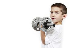 Child lifting dumbbell stock photography