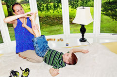 Child lifting foot to girl to tickle. Barefoot of boy being tickled by his sister Royalty Free Stock Image