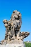 Child with lion statue , Alexander's III bridge Stock Image