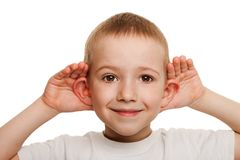 Child listening. Smiling human child hand listening deaf ear gossip Royalty Free Stock Photo