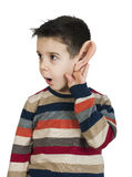 Child listening with ear Royalty Free Stock Images