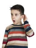 Child listening with ear. White isolated studio shot stock photo