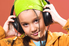 Child listening music in headphones Royalty Free Stock Image