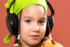 Child listening music in headphones Stock Image