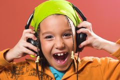 Child listening music in headphones Royalty Free Stock Photo