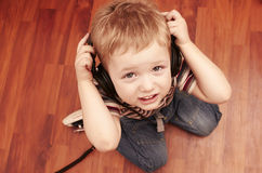 Child listening a music in headphones Royalty Free Stock Photography