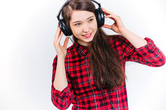 Child listening music. The child listens to music in the Studio on a white background Stock Images