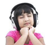 child listening music pretty to Royaltyfri Fotografi
